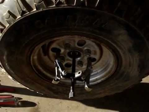Removing a stuck brake drum on a Honda Atv  YouTube