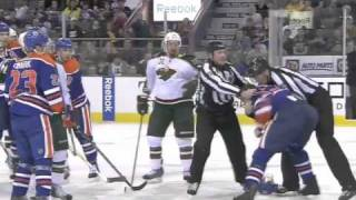 Hockey fights, 4 in first 10 minutes.  Oilers vs. Wild