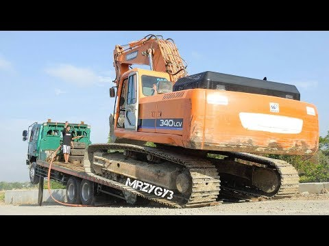 Oversize Load 34 Ton Excavator Transported By Fuso Self Loader Truck Doosan 340LCV