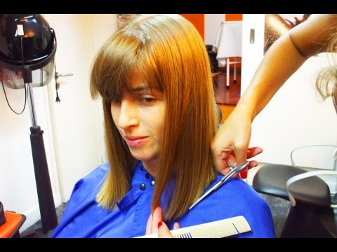 Gorgeous sweet girl getting a romantic bob hairstyle with bangs