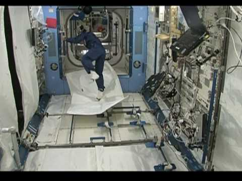 Japan astronaut tests 'flying carpet' in space
