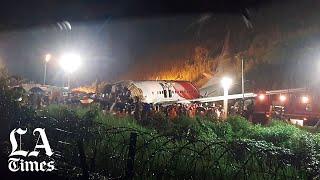 Plane skids off runway in India; 16 killed