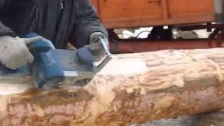 Обработка поверхности бревна