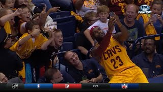 LeBron takes selfie with Kid's phone during game - awesome moment!