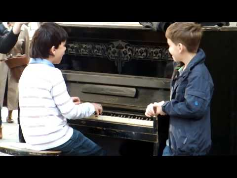 Piano prodigy kid performing on