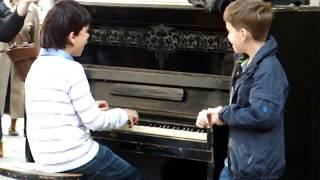 "Piano prodigy kid performing on ""Session street"" in Lviv"