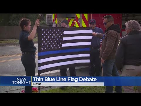 Picture Of Late Officer With Flag Sparks Debate