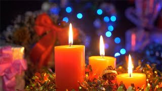 Bokeh shot of perfumed candles rotating on a turntable - festive Christmas background