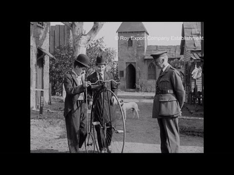 Charlie Chaplin and his Brother Riding a Penny-Farthing - Behind the Scenes Archival Footage