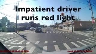 Impatient driver runs red light -