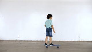 Young handsome kid riding on a skateboard, outdoors - sports lifestyle