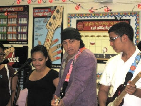 Steven and Maureen Van Zandt delivers guitars to a Little Kids Rock school in the Bronx