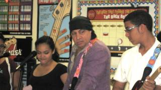 steven and maureen van zandt delivers guitars to a little kids rock school in the bronx