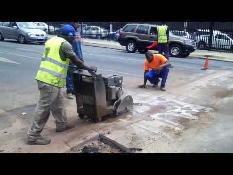Sew cutting a tar surface in Pretoria CBD by SA Royal Deals