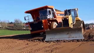 CAT D6 dozer at work on a road construction site (part 1)