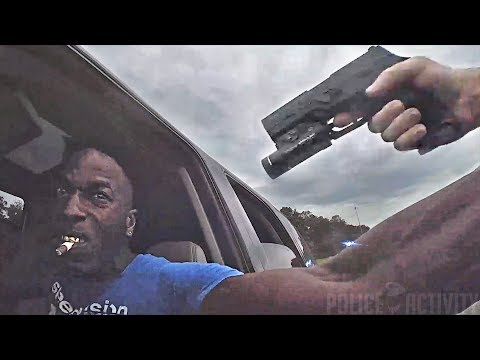 Bodycam Shows Deputy Hanging Onto SUV Before Shooting Driver