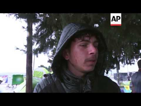 Migrants wait to cross from Greece into Macedonia