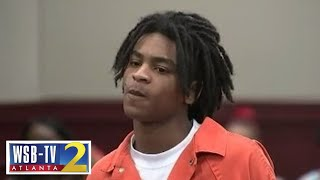 Man charged with murder smirks in court