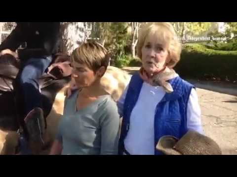 Suzanne Gooch and Suzy Cumming raise money to buy water for horses on Horse Hill. thumbnail