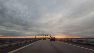 cover image for Driving on Oresundsbron  Malmø to Copenhagen, at sunset 4K.