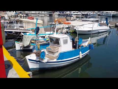 Small beautiful, compact, fishing boats in Piraeus Zea harbor, near Athens, Greece. May 2017.
