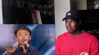 13 year old Jeffrey Li wins a dog from Simon! America