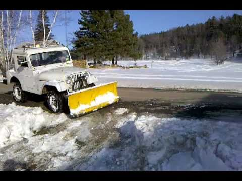 Jeep Wrangler Snow Plow >> plowing snow with jeep cj5 - YouTube