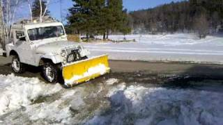 plowing snow with jeep cj5