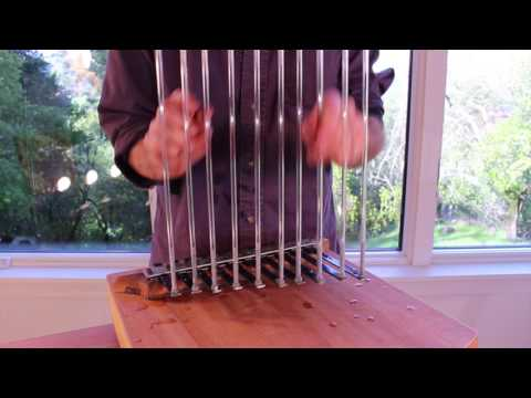 Glass-on-tine — a musical instrument by Bart Hopkin