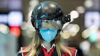 'Smart helmet' introduced at Rome airport to take temperature of passengers | Coronavirus