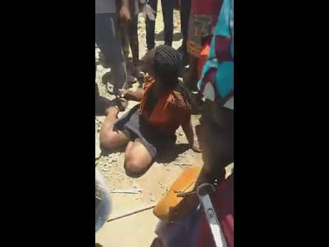 Download GITHURAI RESIDENTS  BEATING UP A LADY FOR STEALING SHOES & MONEY