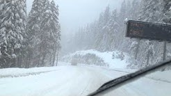 Heavy truck passing Snoqualmie Pass Winter bad Weather