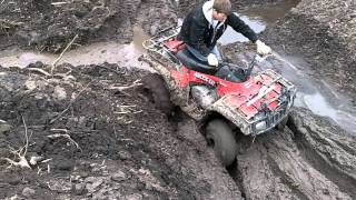four wheeler getting stuck in mud