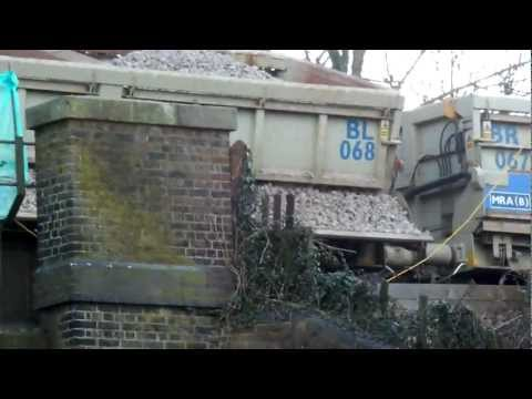 Class 66129 at Dorking Deepdene with waggons 26/02/12  Part1