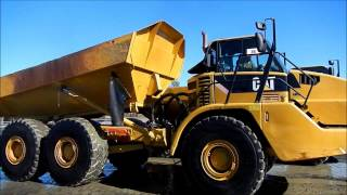Cat 740 Haul Truck Dumping Water