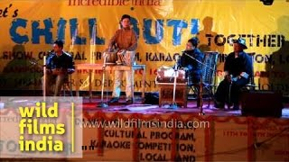 Classical artist of Sikkim performing with harmonium at Winter Carnival