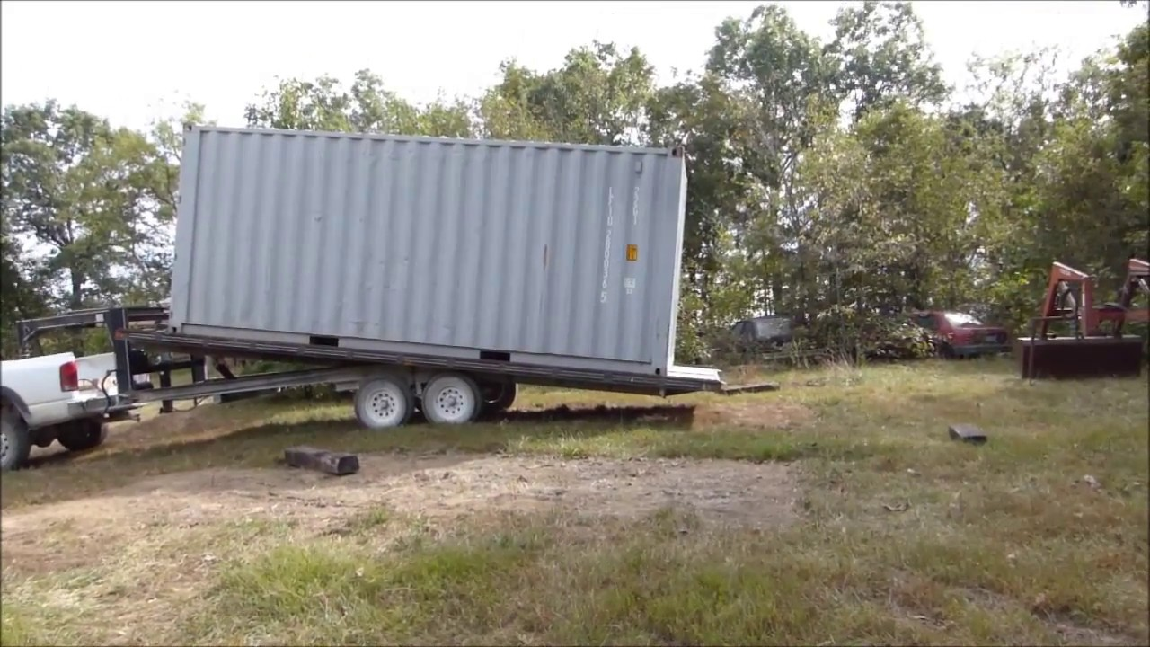 Trailer Unloading 20 Shipping Container Onto Timbers