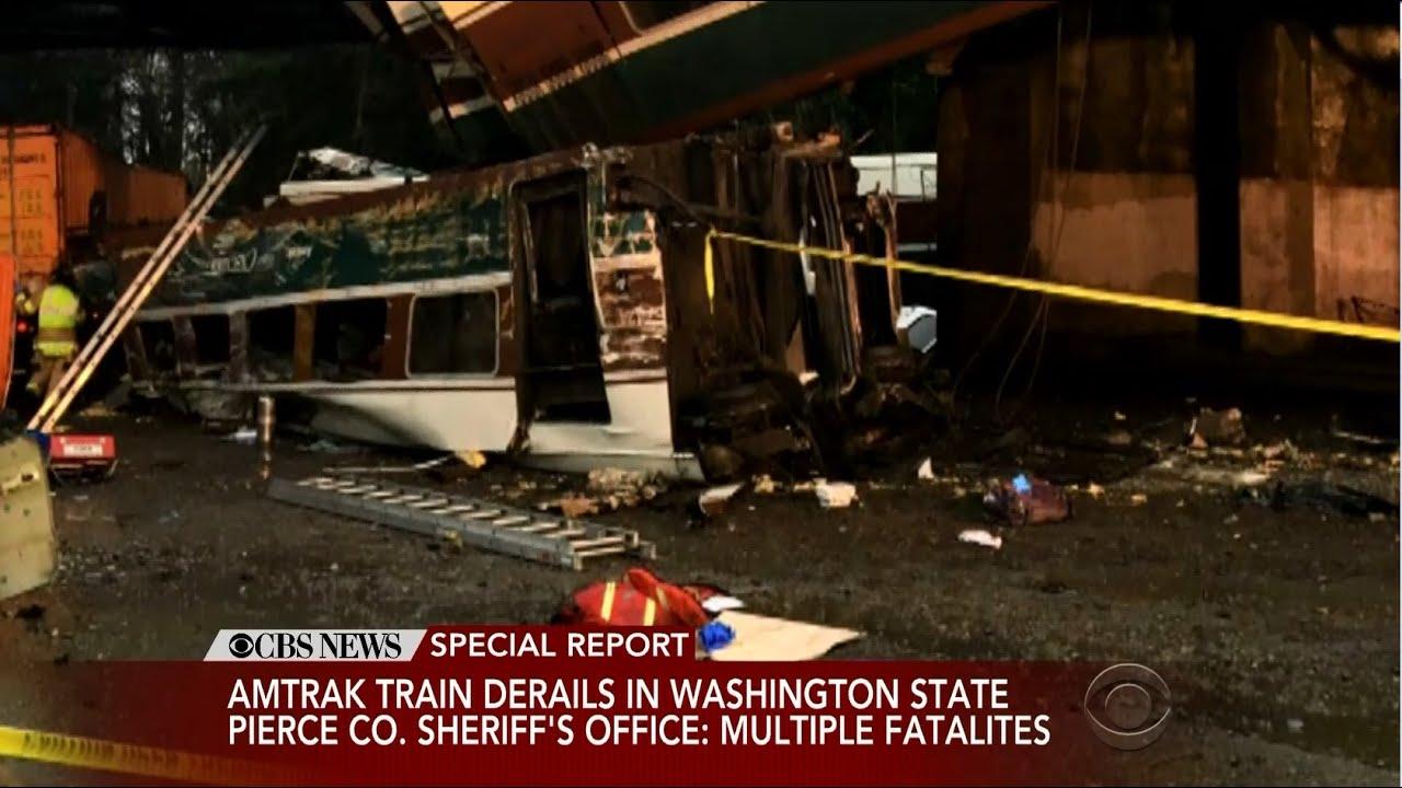 'Multiple' fatalities as Amtrak train derails, dangles over highway in ...