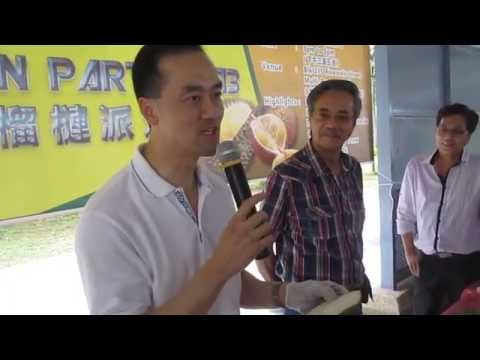 Dr Koh Poh Koon shows how easy it is to open a durian.