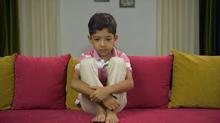Young innocent child sitting alone and crying - showing sad mood