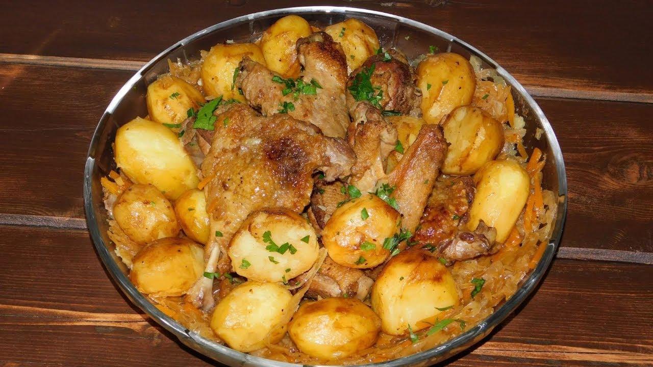 Жареная утка в казане с картофелем.