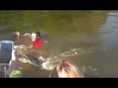 Man swims with gator