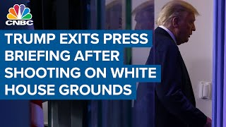 President Donald Trump exits press briefing after shooting on White House grounds