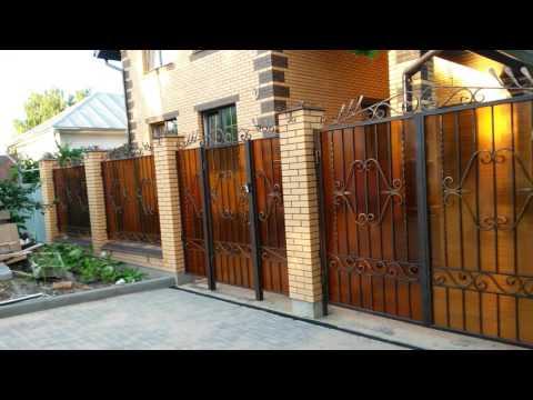 Наши работы. Кованый забор с распашными воротами и калиткой.