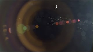 A Crescent Earth and Venus rising over the Moon
