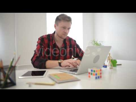 Creative Freelance Designer Working with Laptop - Stock Footage | VideoHive 15653095