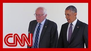 Democratic presidential candidate bernie sanders is tying himself to former president barack obama in a new tv ad despite years of criticizing him and his ad...