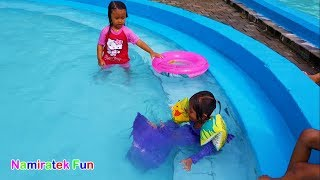 Toddlers Happy Learning Swimming with mermaid Fun Kids Learn Swimming Underwater in Swimming Pool
