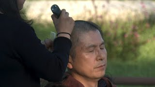 South Korea opposition party leader shaves head in protest | AFP