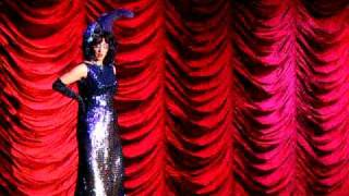 "Miss Indigo Blue, The TwirlyGirl, performs her signature act ""Blue ..."